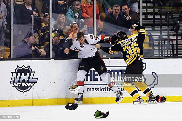 David Dziurzynski of the Ottawa Senators and Zac Rinaldo of the Boston Bruins fight during the third period at TD Garden on December 29 2015 in...
