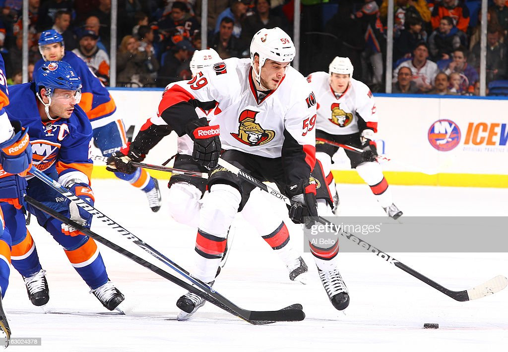 David Dziurzynski #59 of the Ottawa Senators skates against the New York Islanders during their game at Nassau Veterans Memorial Coliseum on March 3, 2013 in Uniondale, New York.