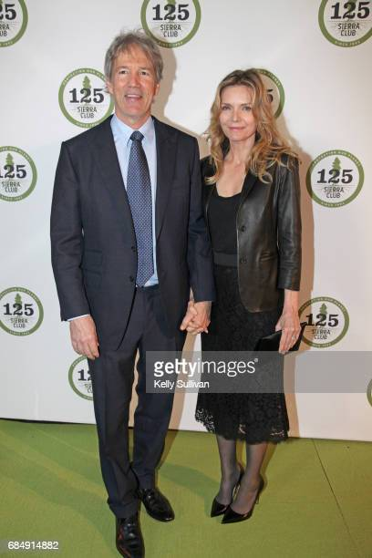 David E Kelley and Michelle Pfeiffer pose for a photograph during the Sierra Club's 125th Anniversary Trail Blazer's Ball at Innovation Hangar on May...