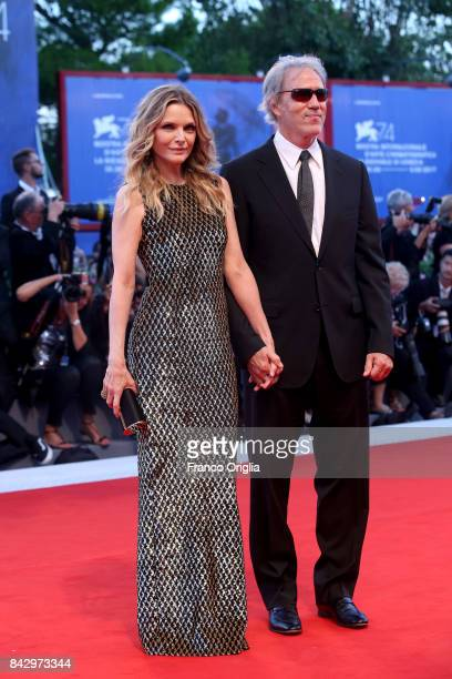 David E Kelley and Michelle Pfeiffer walk the red carpet ahead of the 'mother' screening during the 74th Venice Film Festival at Sala Grande on...