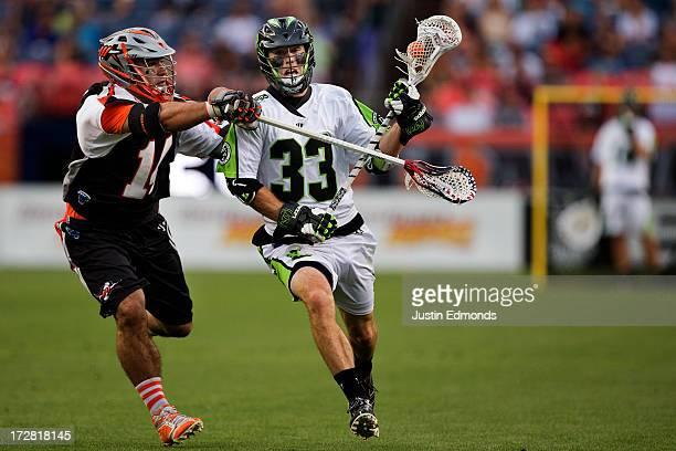 David Earl of the New York Lizards drives towards the net against Justin Pennington of the Denver Outlaws during the first quarter at Sports...