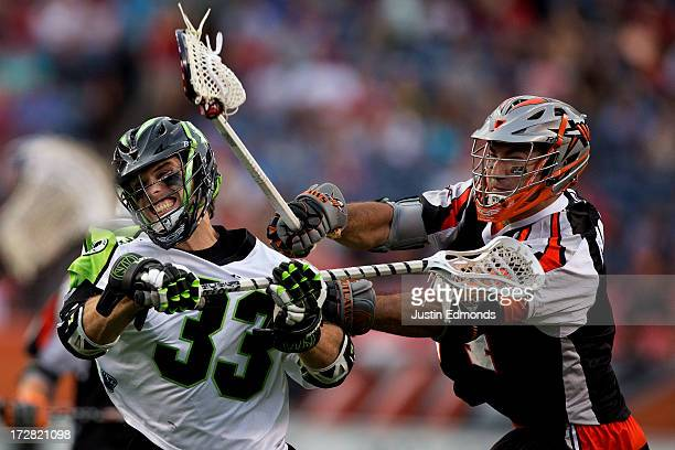 David Earl of the New York Lizards takes a shot after eluding Justin Pennington of the Denver Outlaws at Sports Authority Field at Mile High on July...