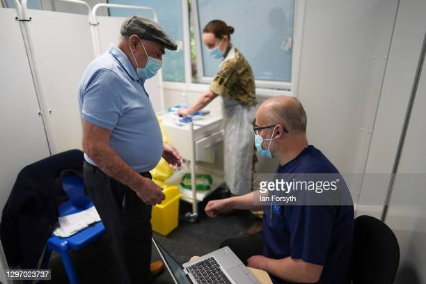 David Eastoe arrives to receive the AstraZeneca/Oxford University covid-19 vaccination at the Askham Bar Mass Vaccination Centre in York on January...