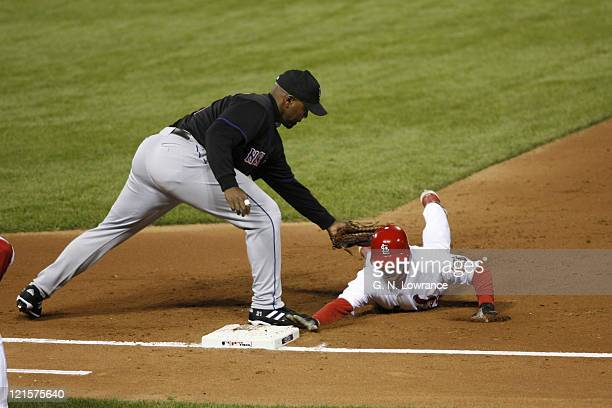 David Eckstein of the Cardinals is tagged out by Carlos Delgado on a pick off during game 3 of the NLCS between the New York Mets and St. Louis...