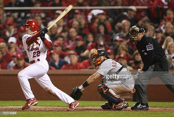 David Eckstein of the St Louis Cardinals hits a RBI double against the Detroit Tigers during the third inning of Game Four of the 2006 World Series...