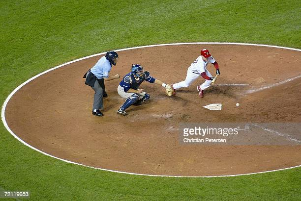 David Eckstein of the St. Louis Cardinals hits an RBI sacrifice bunt against the San Diego Padres during the sixth inning of Game Four of the...