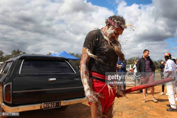David Edwards a Mutthi Mutthi Elder bows his head as he prepares to welcome Mungo Man back to country during a ceremony on November 16 2017 in...
