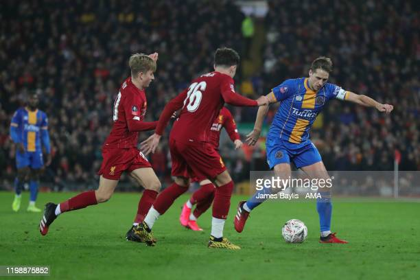David Edwards of Shrewsbury Town and Neco Williams of Liverpool during the FA Cup Fourth Round Replay match between Liverpool and Shrewsbury Town at...