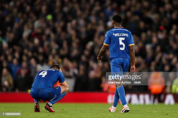 David Edwards of Shrewsbury Town and RoShaun Williams of Shrewsbury Town dejected at full time during the FA Cup Fourth Round Replay match between...