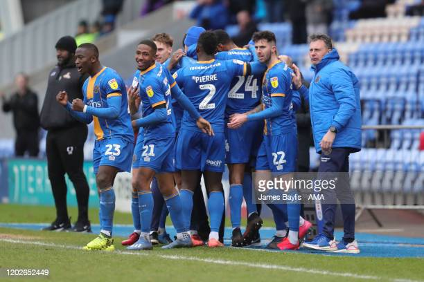 David Edwards of Shrewsbury Town celebrates after scoring a goal to make it 10 with his team mates and the coaching staff during the Sky Bet League...