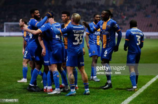 David Edwards of Shrewsbury Town celebrates with his team mates after scoring a goal to make it 01 during the FA Cup First Round Replay match between...