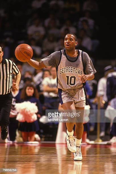 David Edwards of the Georgetown Hoyas dribbles up court during a basketball game at Capital Centre on February 8 1990 in Landover Maryland