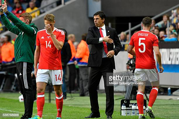 David Edwards of Wales Chris Coleman head coach of Wales and James Chester of Wales during the international friendly between Sweden and Wales at...