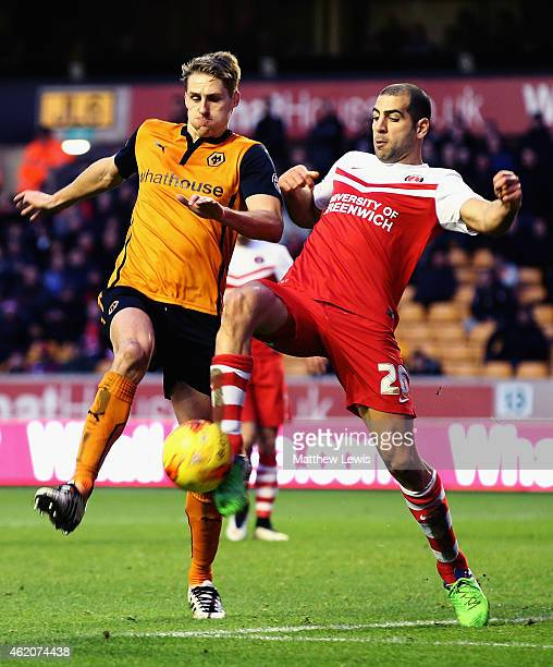 David Edwards of Wolverhampton Wanderers and Tal Ben Haim of Charlton Athletic challenge for the ball during the Sky Bet Championship match between...