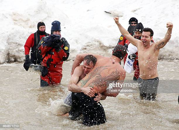 David Eigenberg, Taylor Kinney and Jon Seda participates in the Chicago Polar Plunge 2015 at North Avenue Beach on March 1, 2015 in Chicago, Illinois.