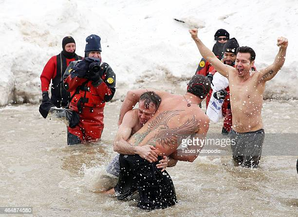David Eigenberg Taylor Kinney Jon Seda and Lady Gaga participates in the Chicago Polar Plunge 2015 at North Avenue Beach on March 1 2015 in Chicago...