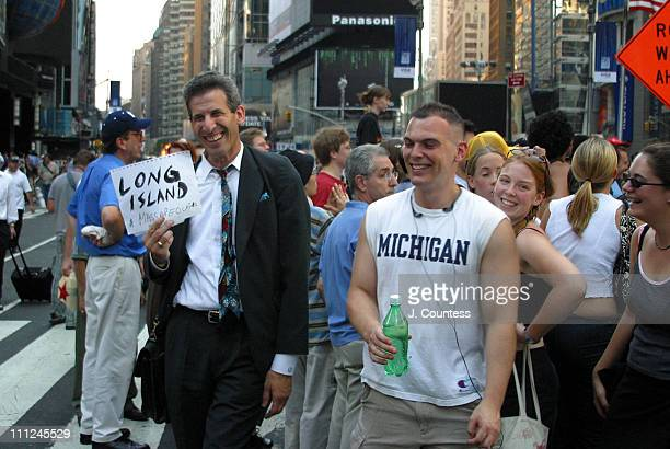 David Eisenberg tries to catch a ride to Long Island as he stands Times Square during the largest power blackout in American history August 14 2003...