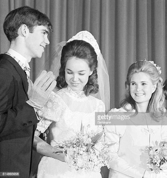 David Eisenhower and Julie Nixon beam happily at their wedding in December 1968. Julie's sister Patricia smiles with them. | Location: Marble...