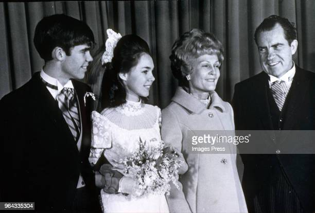 David Eisenhower and wife Julie Eisenhower pose with with her parents Pat Nixon and Presidentelect Richard Nixon after their wedding ceremony