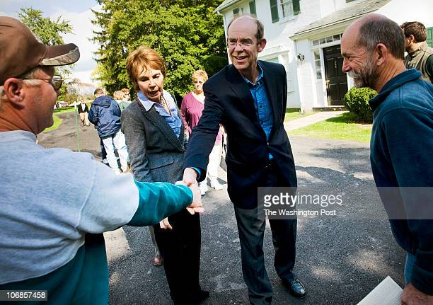 David Eisenhower, center right, shakes hands with tourists as he and wife Julie Nixon Eisenhower, center left, visit the home of his late...