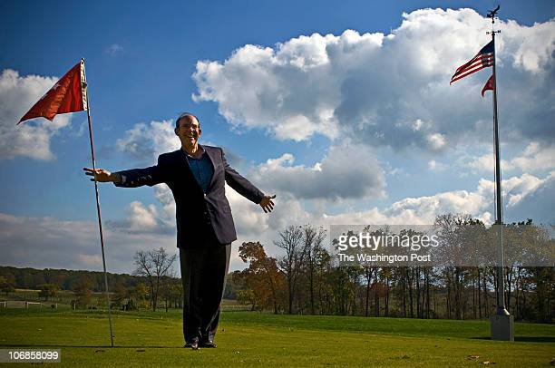 David Eisenhower grabs the presidential golf flag on the putting green that his late grandfather, President Dwight Eisenhower, had installed at his...