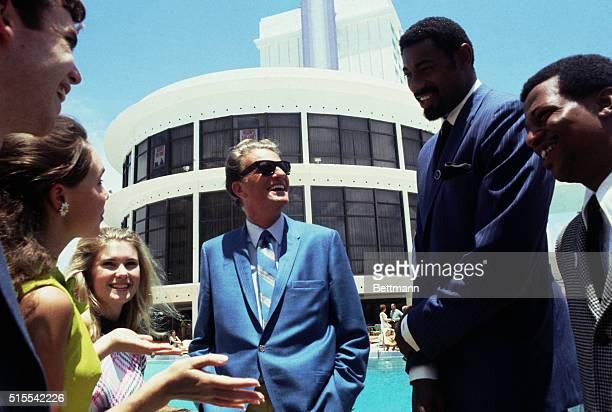 David Eisenhower grandson of former President Eisenhower, and his fiance Julie Nixon daughter of Richard Nixon, are shown with basketball star Wilt...