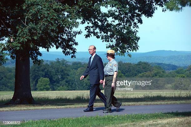 David Eisenhower, grandson of President Dwight D. Eisenhower, walks the grounds with Carol Hegeman, National Park Service historian, at the...