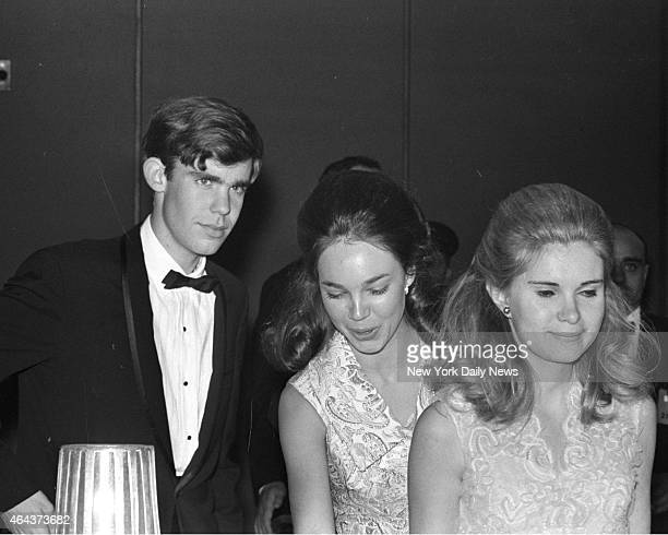 David Eisenhower, his wife, Julie, and Tricia Nixon are in the swing at Young America Miniball at Washington Hilton. Tricia presided over the ball...