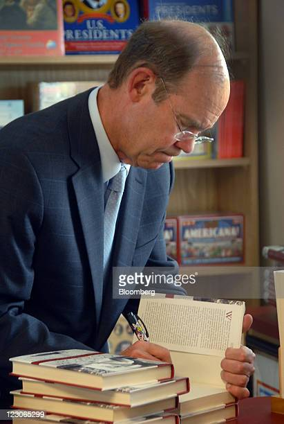 """David Eisenhower signs a copy of his book, """"Going Home to Glory,"""" in the reception center of the Eisenhower National Historic Site in Gettysburg,..."""