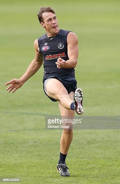 David Ellard kicks the ball during a Carlton Blues AFL training session at Ikon Park on April 1 2015 in Melbourne Australia