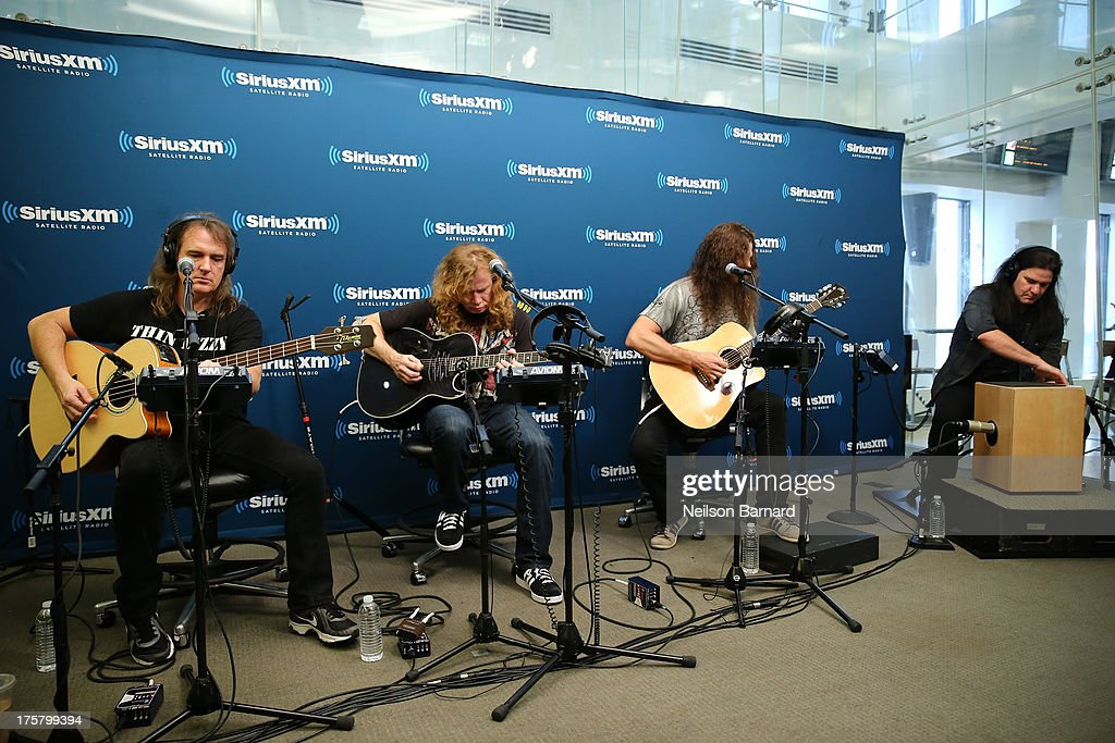 David Ellefson, Dave Mustaine, Chris Broderick and Shawn Drover of Megadeth perform at SiriusXM Studios on August 8, 2013 in New York City.