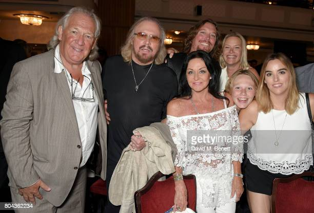 David English Barry Gibb Linda Gibb Ashley Gibb Therese Gibb Lucas Gibb and Alexandra Gibb attend the Nordoff Robbins O2 Silver Clef Awards at The...