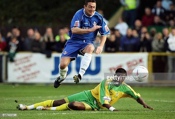 David Eyres of Oldham jumps a tackle from Tresor Kandol of Thurrock during the FA Cup First Round match between Thurrock and Oldham Atheltic at The...