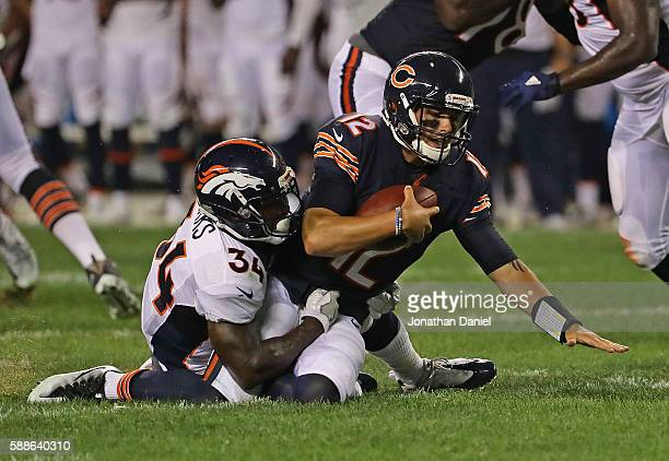 David Fales of the Chicago Bears is sacked by Will Parks of the Denver Broncos at Soldier Field on August 11 2016 in Chicago Illinois The Broncos...