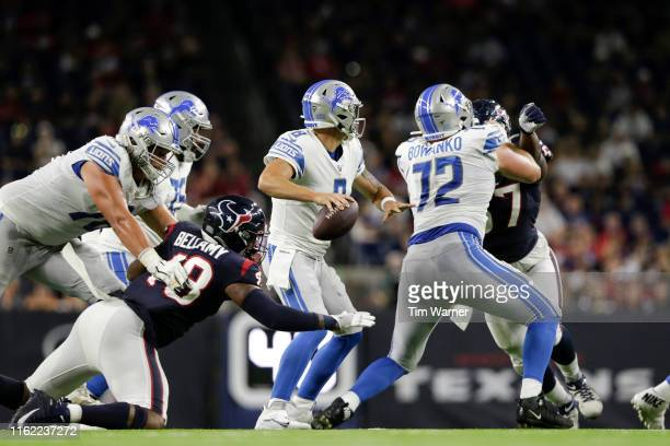 David Fales of the Detroit Lions looks to pass under pressure by Davin Bellamy of the Houston Texans in the third quarter during the preseason game...