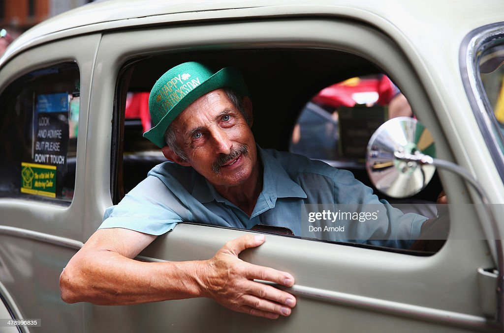 David Farah poses prior to driving his vintage car in the parade on March 16, 2014 in Sydney, Australia. St Patrick's Day is an annual religious and cultural commemoration of the widely recognised patron saint of Ireland, Saint Patrick. March 17th, is a public holiday in Northern Ireland and the Republic of Ireland but is celebrated in many countries around the world where Irish diaspora have settled.