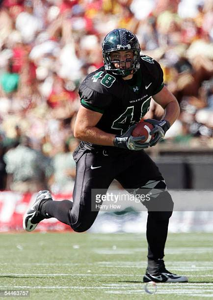 David Farmer of Hawaii runs with the ball after a pass against USC during a 1763 loss at Aloha Stadium on September 3 2005 in Honolulu Hawaii