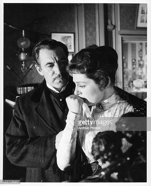 David Farrar tries to comfort Viveca Lindfors in a scene from the film 'I Accuse' 1958