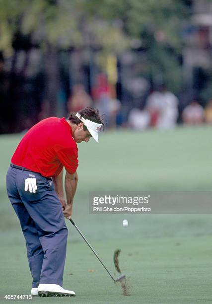 David Feherty of Great Britain chips onto the green during the US PGA Championship held at the Crooked Stick Golf Course in Indiana circa August 1991...
