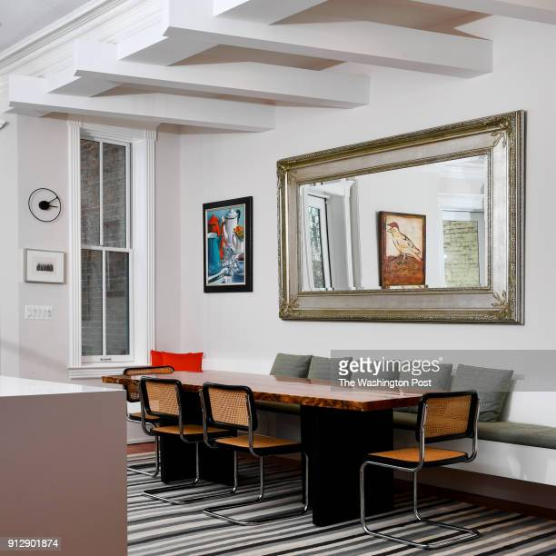 David Feinstein and Susan Pitman's renovated home features beams above the dining area along with a built in bench for ample seating January 04 2018...