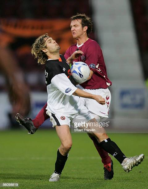 David Fernandez of Dundee United challenges Andy Webster of Hearts during the Scottish Premier League match between Heart of Midlothian and Dundee...