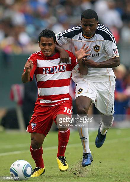 David Ferreira of FC Dallas and Edson Buddle of the Los Angeles Galaxy vie for position to the ball during their MLS match on October 24 2010 in...