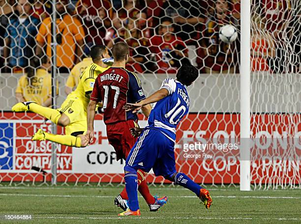 David Ferreira of FC Dallas scores the game winning goal past goalie Javier Morales of Real Salt Lake as Chris Wingert looks on during the second...