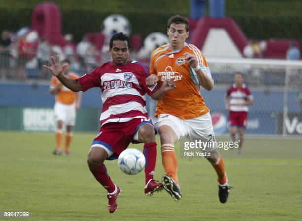 David Ferreira of the FC Dallas kicks the ball away from Geoff Cameron of the Houston Dynamo at Pizza Hut Park August 6, 2009 in Frisco, Texas.