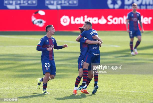 David Ferreiro of SD Huesca celebrates with Dani Escriche and team mates after scoring their side's third goal during the La Liga Santander match...