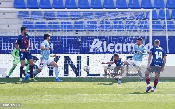 David Ferreiro of SD Huesca scores their side's third goal during the La Liga Santander match between SD Huesca and RC Celta at Estadio El Alcoraz on...