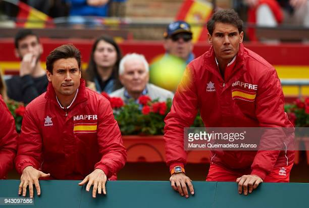 David Ferrer and Rafael Nadal of Spain react for Feliciano Lopez and Marc Lopez of Spain in action againist Tim Puetz and JanLennard Struff of...