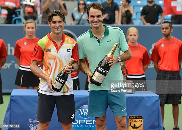 David Ferrer and Roger Federer celebrate with Moet Chandon the official champagne of the Western Southern Open following Federers victory of the...