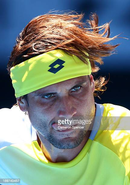 David Ferrer of of Spain competes in his fourth round match against Kei Nishikori of Japan during day seven of the 2013 Australian Open at Melbourne...