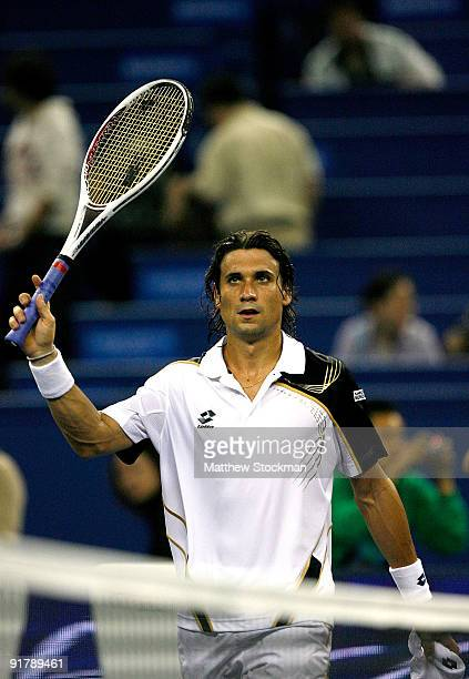 David Ferrer of Spain acknowledges the crowd after defeating Richard Gasquet of France during day two of the 2009 Shanghai ATP Masters 1000 at Qi...